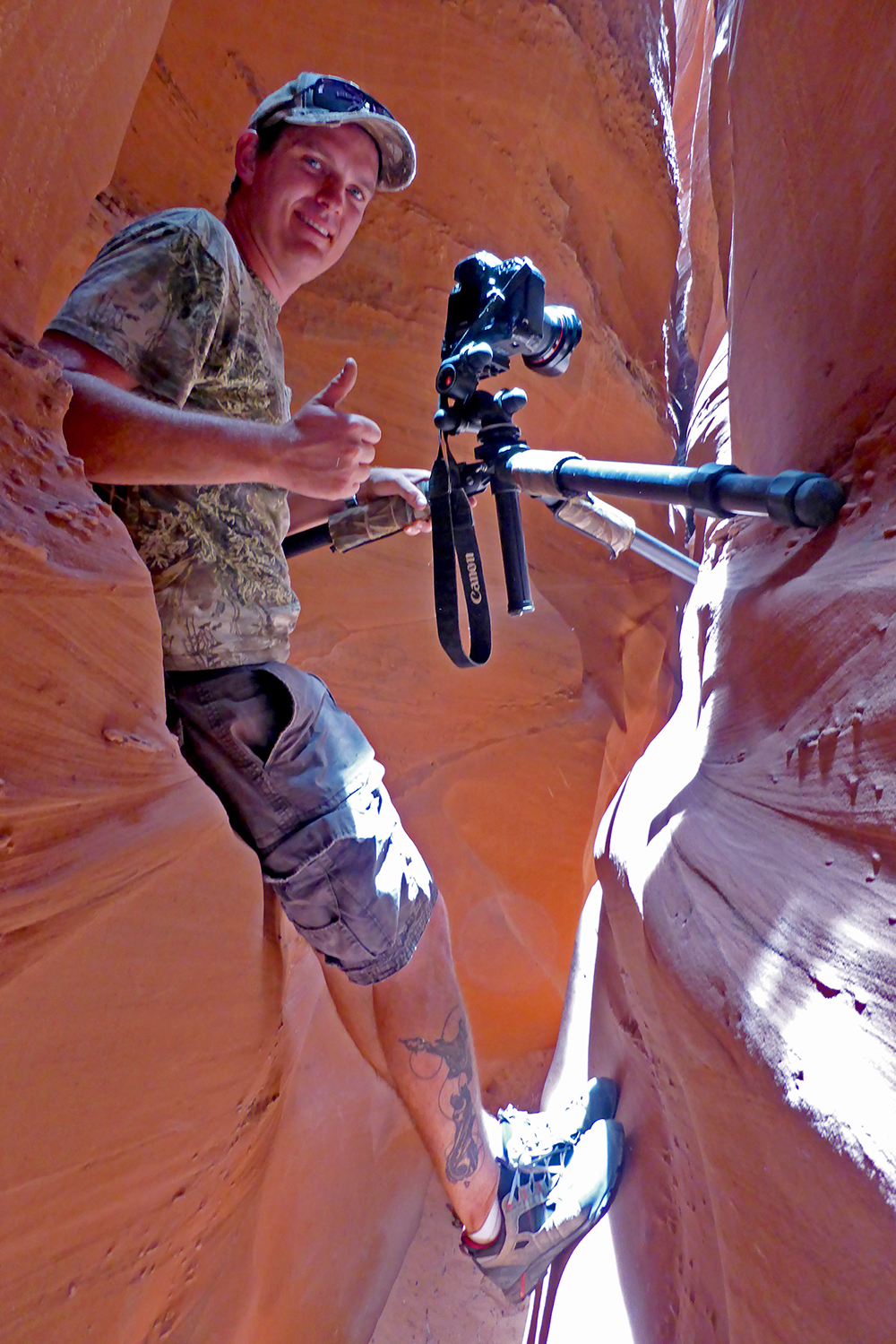 Taking photos in Peek-A-Boo Slot Canyon